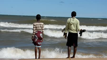 malawi : Children play in the waves