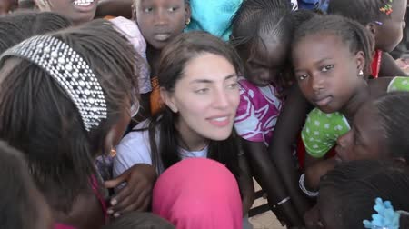 MATAM,SENEGAL-CIRCA NOVEMBER 2013:Actress Caterina Murino greets the children of an elementary school,Caterina Murino is the testimonial of the NGO AMREF,circa November 2013. Stock Footage