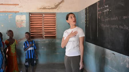 MATAM,SENEGAL-CIRCA NOVEMBER 2013:Actress Caterina Murino sings with children of a primary school, Caterina Murino is the face of the NGO AMREF, circa November 2013.