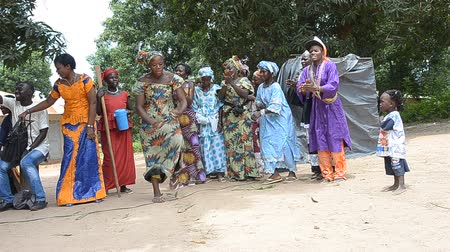 KARTIAK,SENEGAL-CIRCA,SEPTEMBER 2012:African women dancing to celebrate the rite of initiation which takes place every 30 years in the village of Kartiak, Senegal about September 2012  Stock Footage