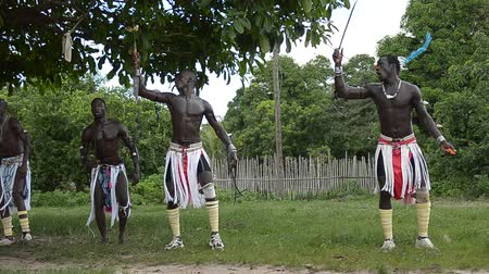 посвящение : KARTIAK,SENEGAL-CIRCA,SEPTEMBER 2012: African men dance to celebrate the rite of initiation which takes place every 30 years in the village of Kartiak, Senegal about September 2012