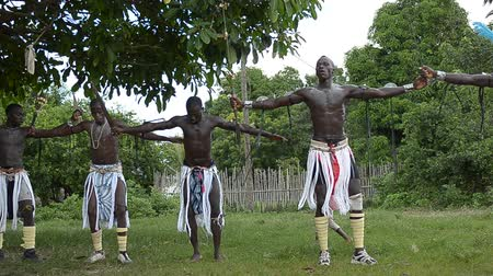 KARTIAK,SENEGAL-CIRCA,SEPTEMBER 2012: African men dance to celebrate the rite of initiation which takes place every 30 years in the village of Kartiak, Senegal about September 2012