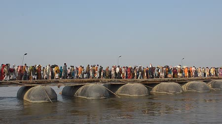 ALLAHABAD,INDIA-CIRCA,FEBRUARY 2013:Thousands of people crossing the bridge over the Ganges in the days of the Kumbh Mela,the largest gathering of people on the history in Allahabad, India February 2013 Stock Footage