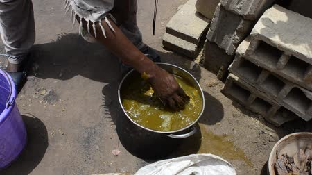 African man prepares natural dye for fabrics  Stock Footage