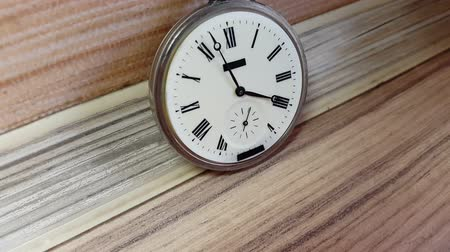 pm : Pocket watch on the background of a wooden wall