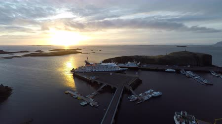 dron : flying over the bay at sunset. moored ships, cruise ship. around the island. Iceland Wideo