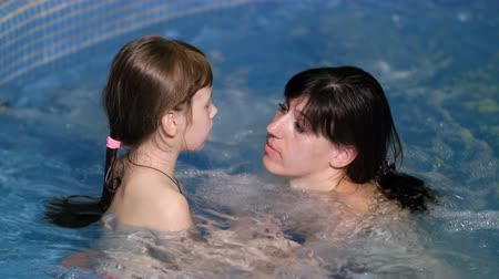hot tub : mother and daughter in hot tub