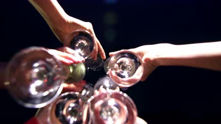 poured out : beautiful girl at a party celebrating the birthday with glasses of champagne in his hands. Stock Footage