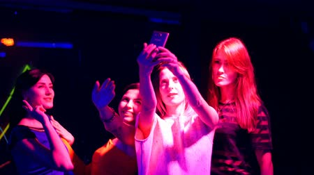 poured out : beautiful girl at a party with your mobile make selfie - disco birthday.