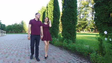 malajsky : beautiful girl and the guy walk in the park.