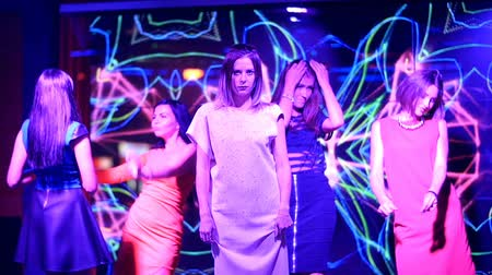 poured out : beautiful girls dancing at a party - disco birthday.