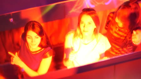 poured out : beautiful girls dancing at a party - in the reflection of the mirror.