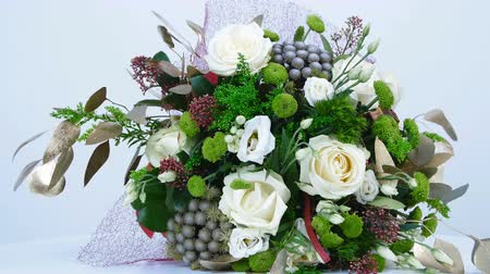 yana : the floral composition consists of eucalyptus, solidago, Rose of avalanche, Santini , Eustoma, Brunia green, Barbatus. Flower bouquet, rotation on white background,