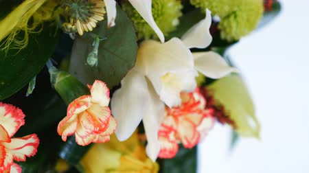 roomy : close-up, rotation on white background, floral composition consists of Rose penny lane, Carnation, Cymbidium orchid, solidago, Chrysanthemum santini, Russus, aspidistra Stock Footage