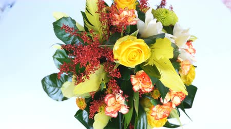 yana : view from above, rotation on white background, floral composition consists of Rose penny lane, Carnation, Cymbidium orchid, solidago, Chrysanthemum santini, Russus, aspidistra Stock Footage