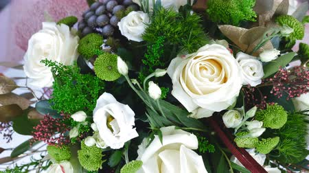 barbatus : view from above, close-up, the floral composition consists of eucalyptus, solidago, Rose of avalanche, Santini , Eustoma, Brunia green, Barbatus. Flower bouquet, rotation on white background, Stock Footage