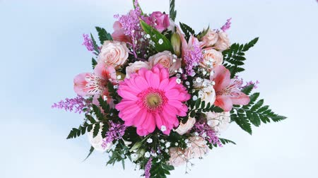 yana : view from above, Flowers, bouquet, rotation on white background, floral composition consists of gerbera, Eustoma, Rose yana creamy, Alstroemeria, solidago, gypsophila, Arachniodis, Rose