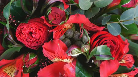 yana : view from above, close-up. Flowers, bouquet, rotation , floral composition consists of Alstroemeria, Rose prestige, Brunia green, solidago, eucalyptus, Rose pion-shaped bordeaux