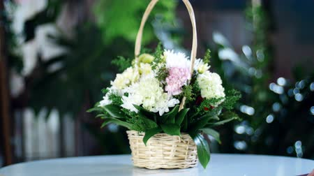 sarıcı : Flower bouquet in the rays of light, rotation, the floral composition in a basket consists of Clove pistachio, Chrysanthemum anastasis, solidago, Russus