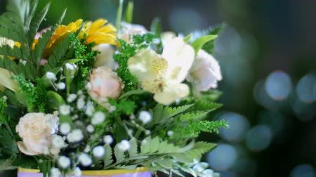barbatus : close-up, Flower bouquet in the rays of light, rotation, the floral composition consists of gerbera, Rose pion-shaped, Alstroemeria, solidago, gypsophila, Arachniodis