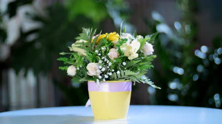 grat : Flower bouquet in the rays of light, rotation, the floral composition consists of gerbera, Rose pion-shaped, Alstroemeria, solidago, gypsophila, Arachniodis