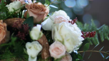 single headed : close-up, Flower bouquet in the rays of light, rotation, consists of Rose cappuccino, Snowflake rose, Rose yana creamy, Plamosus, eucalyptus, solidago, Rose of avalanche.