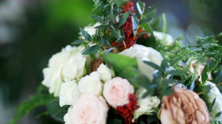 kwiaciarnia : close-up, Flower bouquet in the rays of light, rotation, consists of Rose cappuccino, Snowflake rose, Rose yana creamy, Plamosus, eucalyptus, solidago, Rose of avalanche.