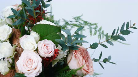 roomy : close-up, Flower bouquet in rotation on white background, consists of Rose cappuccino, Snowflake rose, Rose yana creamy, Plamosus, eucalyptus, solidago, Rose of avalanche.