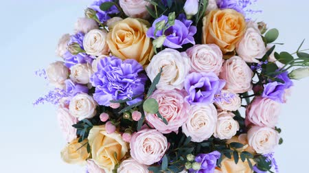 yana : view from above, close-up, Flower bouquet in rotation , floral composition consists of Rose of avalanche, Rose pion-shaped, Carnation, Eustoma, solidago, eucalyptus, Hiperikum.