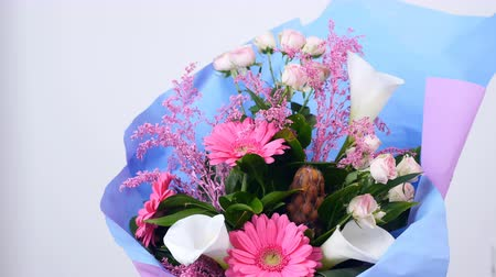 yana : Flowers, bouquet, rotation on white background, floral composition consists of pink gerbera, Protea, calla, Rose yana creamy, solidago Russus