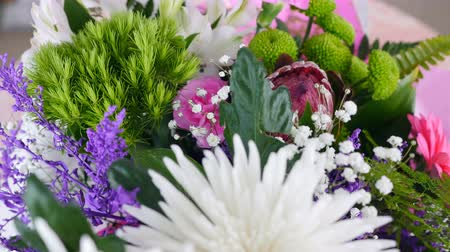 alstroemeria : close-up, view from above, Flowers, bouquet, rotation, floral composition consists of Chrysanthemum anastasis, gypsophila, solidago, Barbatus, Protea, Carnation, gerbera, Stock Footage
