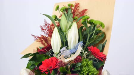 yana : Flowers, bouquet, rotation on white background, floral composition consists of Santini , solidago, lily, gerbera, Barbatus, Russus Stock Footage
