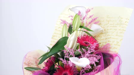 alstroemeria : Flowers, bouquet, rotation on white background, floral composition consists of solidago calla, lily, Gerbera terry Russus