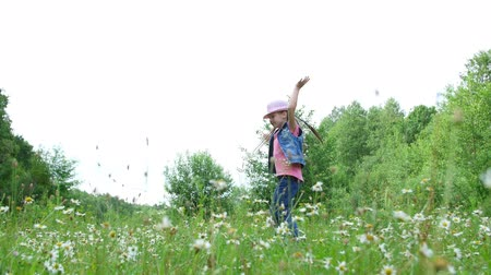 littlegirl : In the grass, among the daisies, in the meadow, dancing, jumping, having fun, a pretty girl, about seven years old. She has long blond hair, is dressed in a denim vest and a pink hat