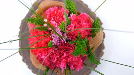 roomy : Top view, close-up of a bouquet of flowers, rotation on a white background. The flower arrangement consists of Carnation, Barbatus. Stock Footage