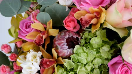 roomy : close-up, view from above, Flowers, bouquet, rotation, floral composition consists of Rose aqua, Ornithogalum, Brunia green, eucalyptus, Cymbidium orchid, Protea, Barbatus,
