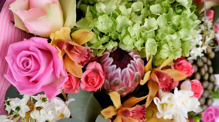 yana : close-up, view from above, Flowers, bouquet, rotation, floral composition consists of Rose aqua, Ornithogalum, Brunia green, eucalyptus, Cymbidium orchid, Protea, Barbatus,
