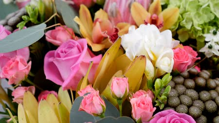 single headed : close-up, view from above, Flowers, bouquet, rotation, floral composition consists of Rose aqua, Ornithogalum, Brunia green, eucalyptus, Cymbidium orchid, Protea, Barbatus,