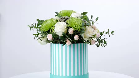 gypsophila : Flowers, bouquet, rotation on white background, floral composition consists of Brunia green, Rose of avalanche, Rose yana creamy, Santini , gypsophila, eucalyptus, pistachio