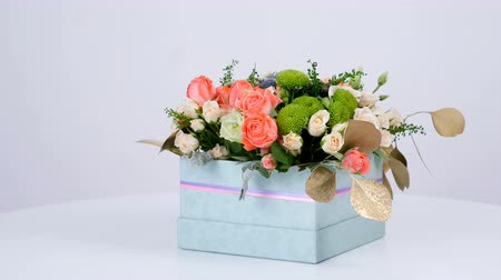 grat : Flowers, bouquet, rotation on white background, floral composition consists of eucalyptus, cineraria, Rose cream grace, Rose barbados, Eustoma, solidago, Santini ,