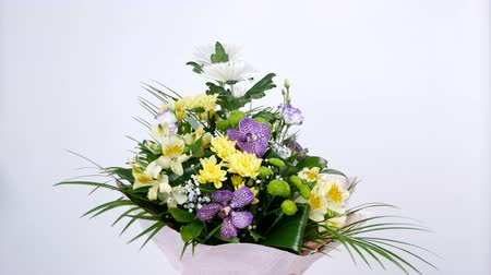 roomy : Flowers, bouquet, rotation on white background, floral composition consists of Orchid vanda, Chrysanthemum, Santini , gypsophila, Alstroemeria, aspidistra, Russus,