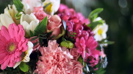 yana : close-up, Flower bouquet in the rays of light, rotation, the floral composition consists of gerbera, Tulip piano, Santini , Alstroemeria, Rose odily, Orchid vanda, eucalyptus