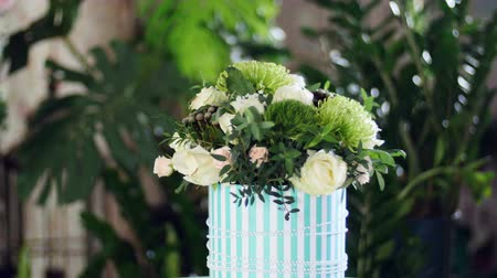 yana : Flower bouquet in the rays of light, rotation, the floral composition consists of Brunia green, Rose of avalanche, Rose yana creamy, Santini , gypsophila, eucalyptus Stock Footage