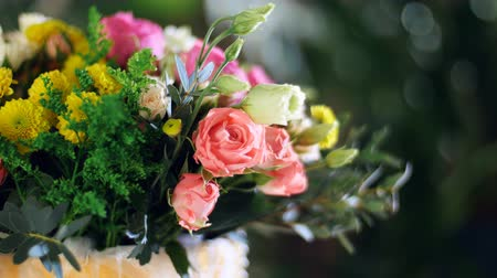 yana : close-up, Flower bouquet in the rays of light, rotation, composition consists of Rose david austin, Rose cream grace, Rose barbados, Eustoma, Santini , Ornithogalum, eucalyptus, Stock Footage