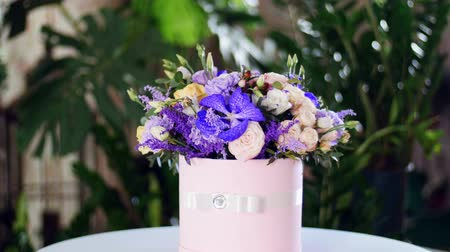 yana : Flower bouquet in the rays of light, rotation, the floral composition consists of Orchid vanda, solidago, Carnation, Hiperikum, Rose pion-shaped, Eustoma, solidago, eucalyptus Stock Footage