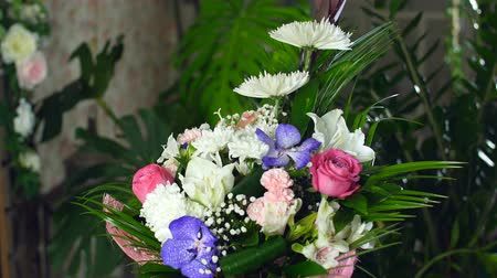 barbatus : Flower bouquet in the rays of light, rotation, the floral composition consists of Leucadendron, Chrysanthemum anastasis, Amaryllis pink, Orchid vanda, Alstroemeria,