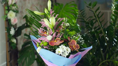 grat : Divine beauty.Flower bouquet in the rays of light, rotation, consists of Orchid vanda, Chrysanthemum bacardi, solidago, Eustoma, Alstroemeria, Santini , gypsophila, Russus , Phoenix robbeli, Amaryllis white, aspidistra