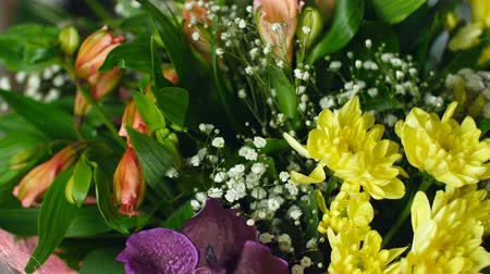 yana : close-up, Flower bouquet in the rays of light, rotation, the floral composition consists of calla, lily, Brunia green, gypsophila, Orchid vanda, Alstroemeria, aspidistra, Russus, Stock Footage