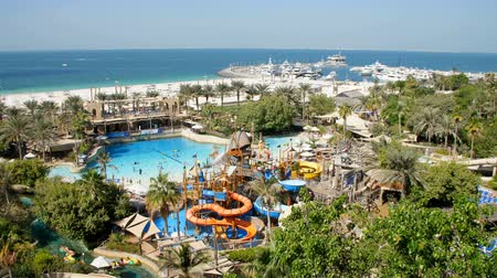 waterslide : DUBAI, UNITED ARAB EMIRATES, UAE - NOVEMBER 20, 2017: Hotel Jumeirah Al Naseem near with Burj al Arab. water park Wild Wadi, on the territory of the hotel