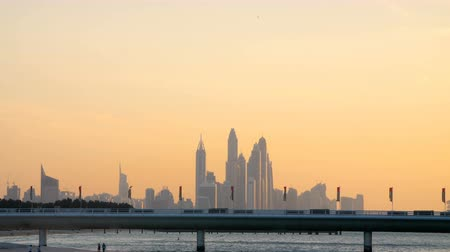 birleşik arap emirlikleri : DUBAI, UNITED ARAB EMIRATES, UAE - NOVEMBER 20, 2017: Hotel Jumeirah Al Naseem near with Burj al Arab. at sunset, in the distance you can see skyscrapers Stok Video